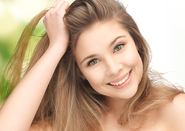 smiling girl with healthy hair and skin
