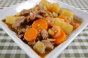 pressure cooker beef stew on a square plate