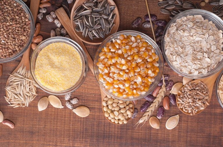 assortment of whole grains in small bowls