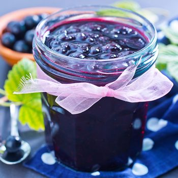 small mason jar of black currant jam