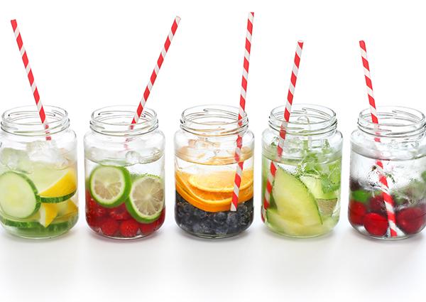 five jars of different fruit infused water recipes side by side