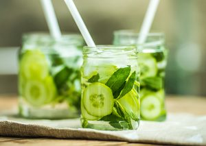 three jars of cucumber and mint infused water