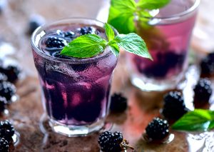 two glasses of blackberry infused water
