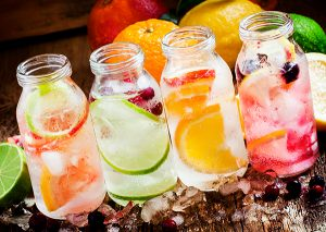 four fruit infused water recipes in jars