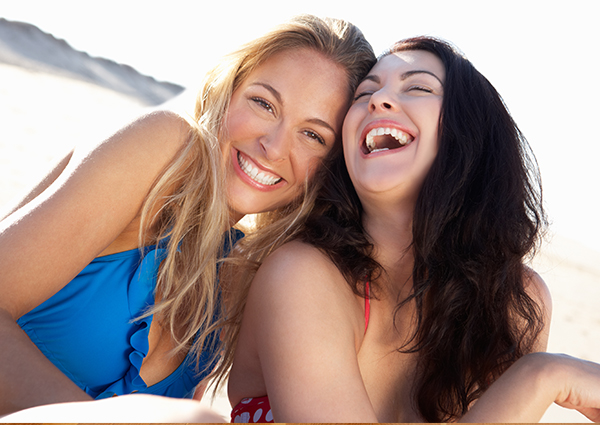 two pretty girls smiling with laughter