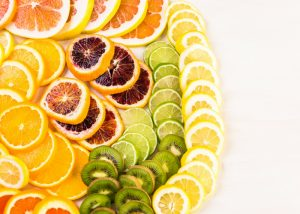 sliced citrus fruits such as oranges, kiwis, lemons that are rich in vitamin c