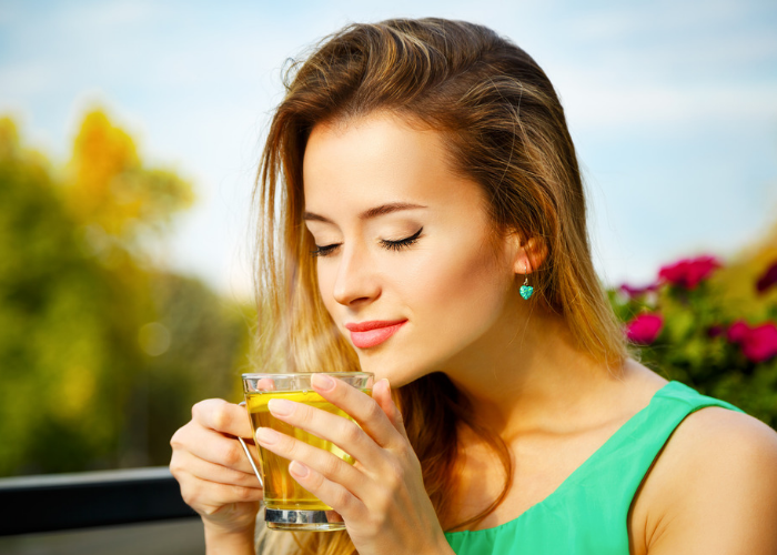Woman drinking green tea outdoors