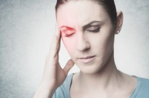 woman touching her temple wishing for migraine headache relief