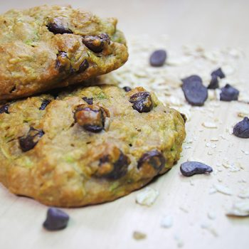 Two homemade oat cookies with chocololate chips