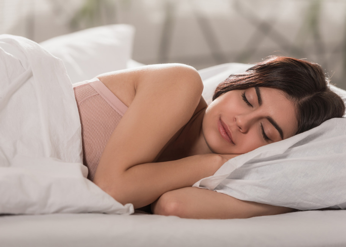 Brunette woman sleeping soundly on her side