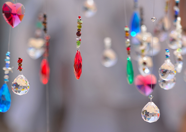 Strings of crystals of different shapes, colors, and sizes dangling