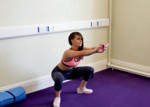 woman doing bodyweight squat butt exercises