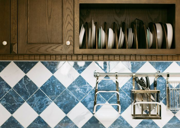kitchen cabinet filled with assorted plates