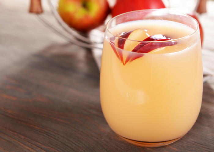 apple cider vinegar drink recipe and apple slices in a glass