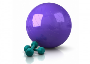 purple exercise ball office chair next to green dumbbells