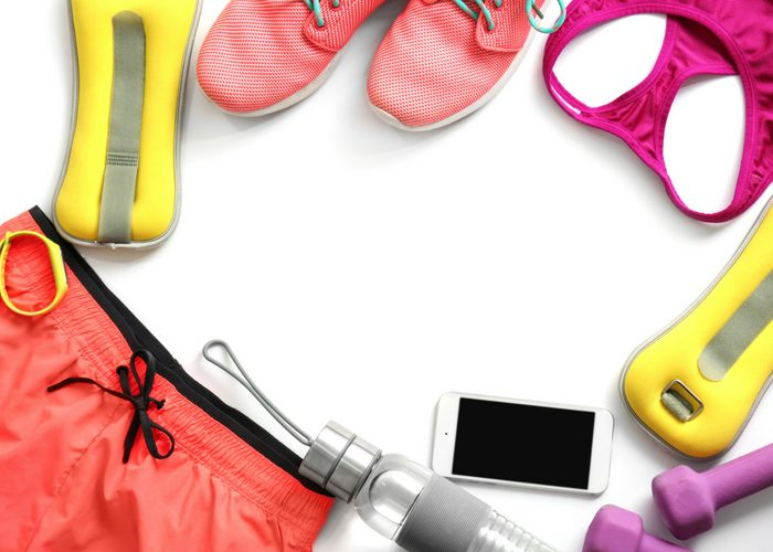 flat lay of exercise equipment and athletic clothing