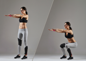 woman doing squats for standing desk exercise