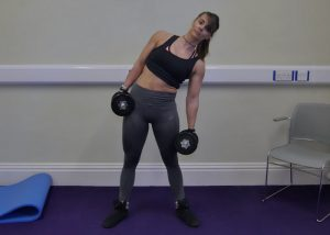 woman doing dumbbell side bend posture correction exercises