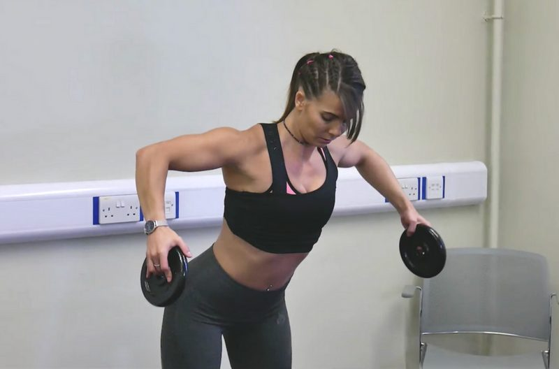Woman holding weights doing exercises to improve posture