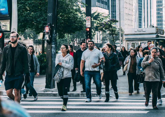 people crossing a busy street in the city