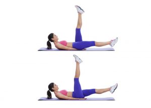 woman lying on exercise mat doing scissor kicks for lower ab exercise