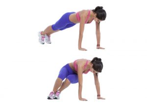 woman on the floor doing ski abs lower ab exercises