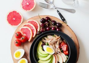 meal kit with sliced avocado apple eggs and grapefruit