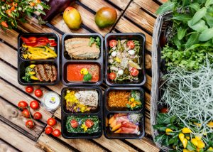 meal kit boxes of fresh salad and healthy vegetables