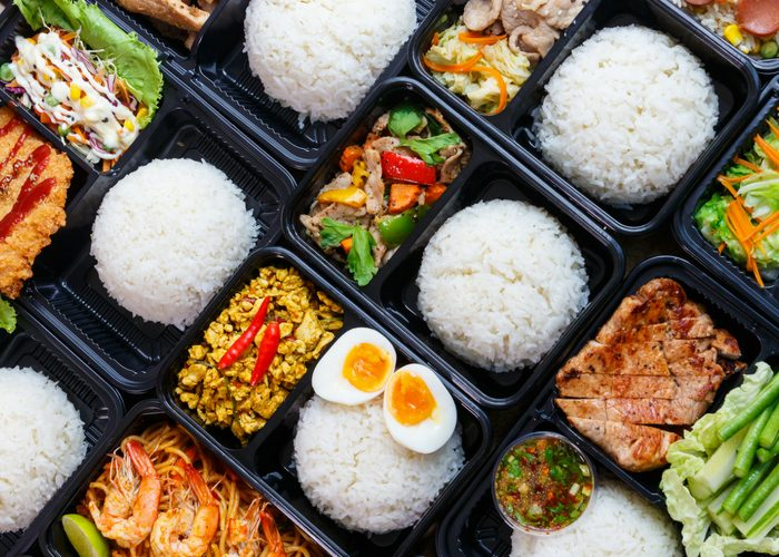 meal prep delivery containers with rice, meat, and veggies