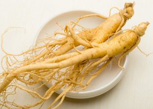ginseng roots on a white dish
