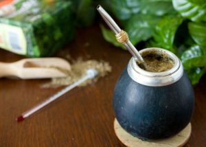 a cup of yerba mate drink with a straw