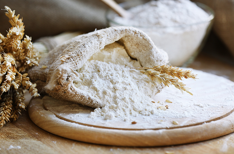 bag of cassava flour spilling onto a cutting board