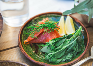 plate with smoked salmon and fresh greens