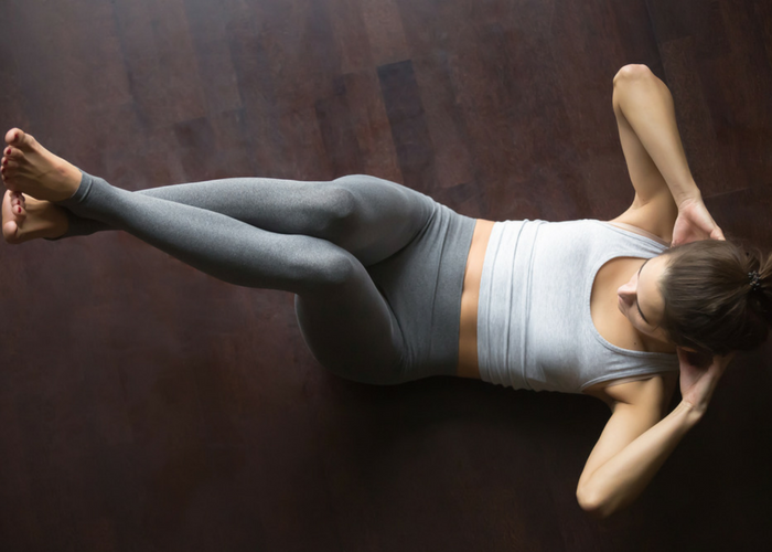 woman doing LIIT ab crunches