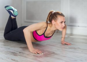 woman doing half push ups