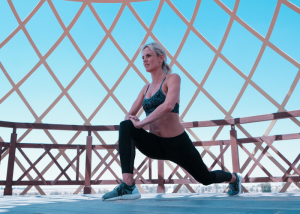 a woman doing lunges in workout gear