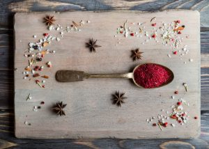 a spoonful of the superfood sumac spice on a table