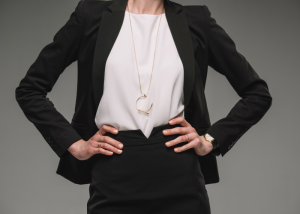 woman dressed in a business suit with hands on her hips