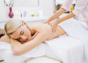 woman getting a massage at a spa