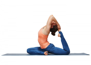 woman performing a yoga pose on a mat