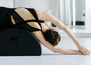 a woman using pilates equipment