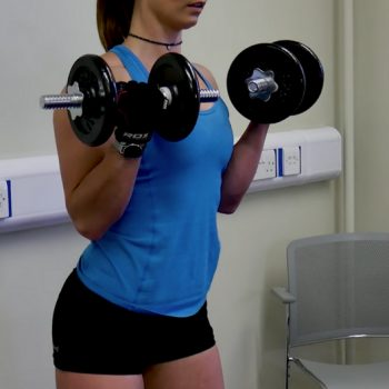 Woman doing dumbbell exercises for arms