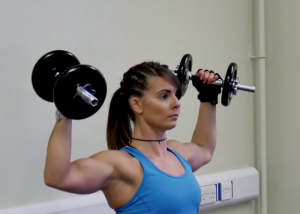 woman doing bicep curl dumbbell exercises for arms