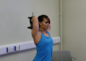woman gripping onto 1 dumbbell doing triceps extension exercises