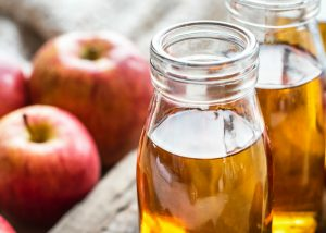 two bottles of apple cider vinegar
