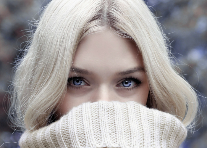 close up of beautiful blonde woman with blue eyes