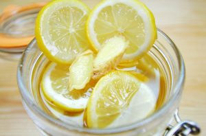 Lemon ginger honey mixture in mason jar for homemade lemon and ginger tea