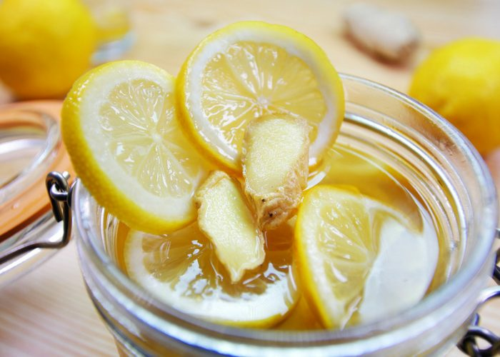 close up of lemon, honey and ginger mixture in mason jar