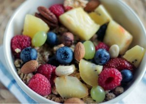 a bowl of fresh fruits and nuts