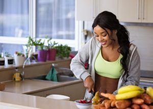 a fit woman prepping her meal in a kitchen
